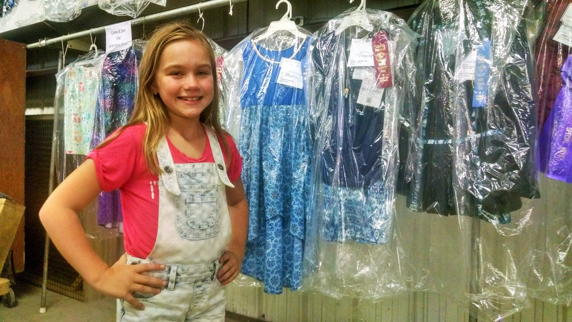 Jessica Reinke stands in front of her projects at the fair