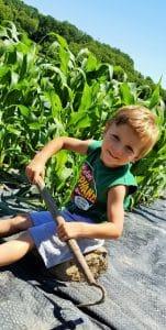 Tucker Grosenick learning to garden